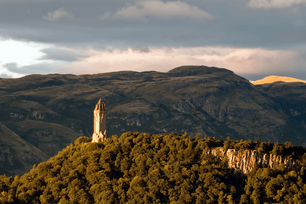 Aerial view of the Wallace Monument on the outskirts of Stirling, one of the cities to visit in Scotland