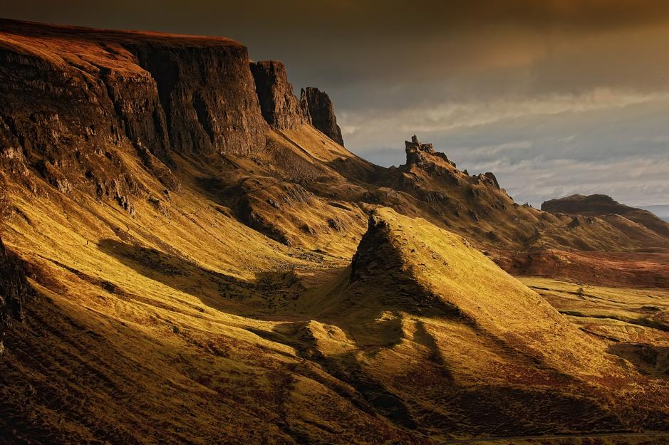 The rugged landscape of the Scottish Highlands bathed in golden light
